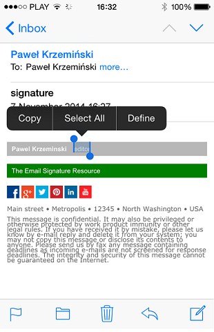 An email containing an HTML email signature with the iPhone context menu